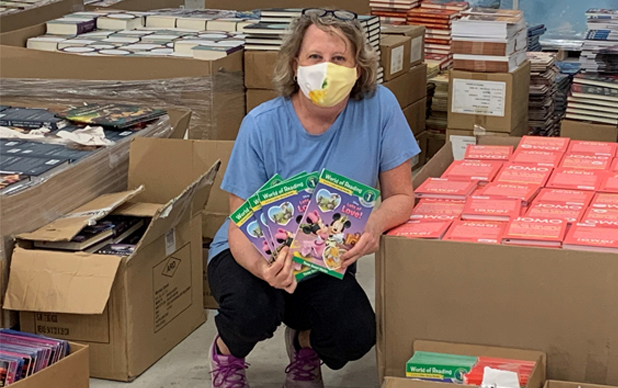 Woman Surrounded By Donated Books